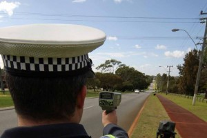 Police officer holding a traffic camera
